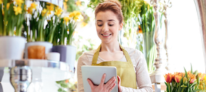 woman florist with ipad